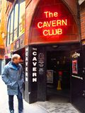Cavern Club Beatles landmark in Liverpool, England. Liverpool, UK – February 24, 2013: A man walks past the Cavern Club in Liverpool, England. The Beatles Stock Photography