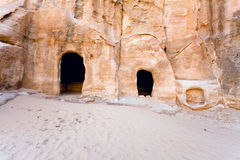 Cavern tombs  near the entrance in Little Petra Royalty Free Stock Photo