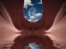 Cavern with water. And moon in sky stock photography