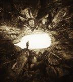 Caverna com cena surreal do homem Fotografia de Stock Royalty Free
