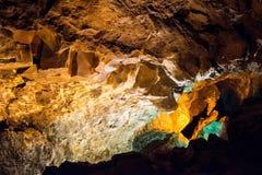 Caverna da lava com luzes Lanzarote Fotografia de Stock