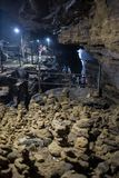 Caverna escura com silhueta do homem Foto de Stock Royalty Free