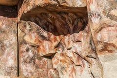Caverne des mains - peintures des personnes antiques, Argentine Photo stock
