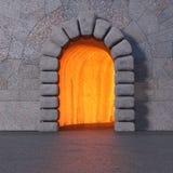 Caverne en pierre avec la lumière du feu à l'intérieur images libres de droits