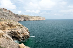 Caves and cliffs at the coastline of Gozo Island Royalty Free Stock Photos
