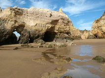 Caves and colourful rock formations on the Algarve Royalty Free Stock Photos