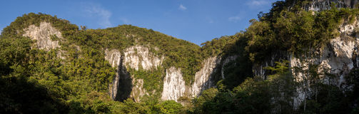 Caves in Gunung Mulu. Panorama with giant caves in Gunung Mulu National Park, Borneo, Malaysia stock image