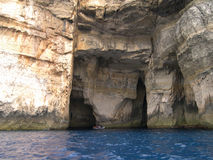 Caves on Malta. Limestone caves in Malta could easily hide boats Royalty Free Stock Photos