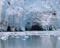 Caves on Margerie Glacier Stock Photography