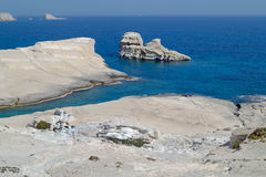 Caves and rock formations by the sea at Sarakiniko area on Milos Stock Images