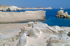 Caves and rock formations by the sea at Sarakiniko area on Milos Royalty Free Stock Photography