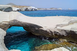 Caves and rock formations by the sea at Sarakiniko area on Milos Stock Photos