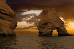 Caves and rock formations by the sea at Sarakiniko area on Milos Royalty Free Stock Image