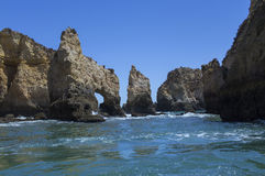 Caves on the shores of the Atlantic Ocean in Lagos Portugal. Royalty Free Stock Photos