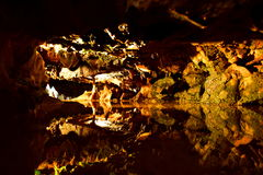 Caves. Stalactites stalagmites dark education dangerous slippery cold damp reflected in the water dark kaleidoscope of stunning beauty of nature Royalty Free Stock Photography