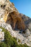 Caves on Telendos Island. Caves on a mountain on Telendos Island, Greece stock photos
