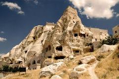 Cavetown antiguo cerca de Goreme, Cappadocia, Turquía Fotos de archivo libres de regalías