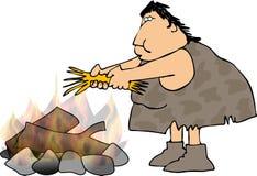 Cavewoman und ein Lagerfeuer Stockfotos