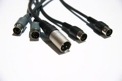 Cavi sani dell'audio su una priorità bassa bianca Fotografia Stock Libera da Diritti