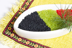 Caviar. In a bowl-shaped over on yellow background stock image