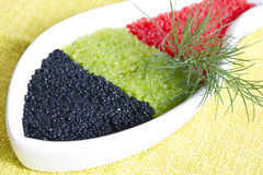 Caviar. In a bowl-shaped over on yellow background stock photos