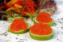 Caviar. Some caviar on a lemon slice Royalty Free Stock Image