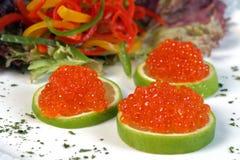 Caviar. Some caviar on a lemon slice royalty free stock photo