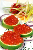 Caviar. Some caviar on a lemon slice royalty free stock photography