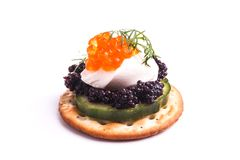 Caviar Appetizer served on crackers Stock Photo