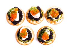 Caviar Appetizer served on crackers Royalty Free Stock Image