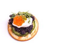 Caviar Appetizer served on crackers Royalty Free Stock Photos