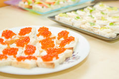 Caviar appetizers. Red caviar and cream appetizers Royalty Free Stock Image
