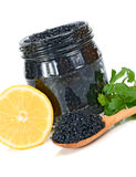 Caviar black in a glass jar with lemon and parsley Royalty Free Stock Photography