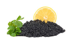 Caviar black in a glass jar with lemon and parsley Royalty Free Stock Images