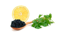Caviar black in a wooden spoon Royalty Free Stock Image