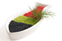 Caviar in a bowl-shaped over. On withe background royalty free stock images