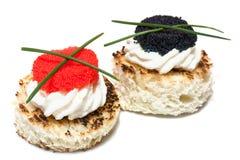 Caviar Canapés en blanco Imagen de archivo