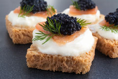 Caviar. Canape of Caviar on top of salmon with cream cheese, room for text stock image