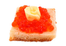 Caviar Canapes. Red Caviar, butter end white bread on a white background Royalty Free Stock Images