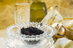 Caviar and champagne. Over luxury table Royalty Free Stock Photo