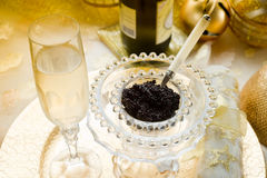 Caviar and champagne. Over luxury table Royalty Free Stock Photography