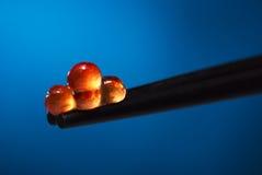 Caviar on a chopsticks. Stock Photos