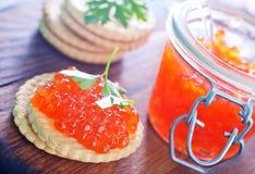 Caviar dos salmões vermelhos Imagens de Stock Royalty Free