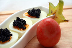 Caviar on eggs Royalty Free Stock Photography