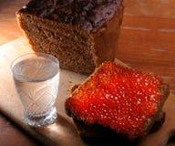 Caviar et vodka Photographie stock libre de droits