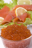 Caviar and fish. Various products caviar red fish lettuce lemon Stock Image