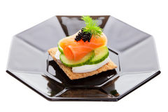 Caviar and goat cheese Stock Images
