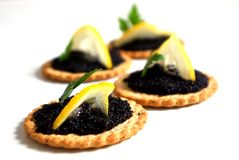 Caviar and lemon on a biscuit Stock Image