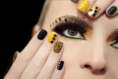 Caviar manicure and makeup. stock photo