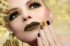 Caviar manicure. Caviar manicure in yellow and black nail Polish on the girl with false eyelashes and rhinestones of different shapes Stock Photography